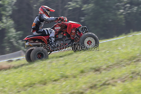 panning shot of young rider on