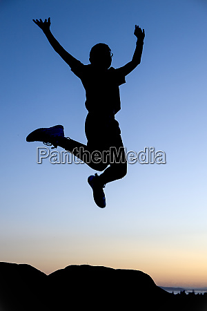jumping for joy at sunset