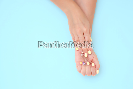 womens hands with a beautiful manicure