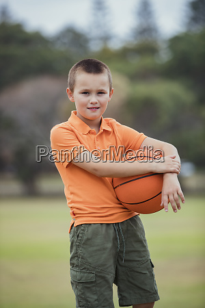 young boy ready to play basketball