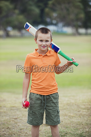 young boy ready to play cricket