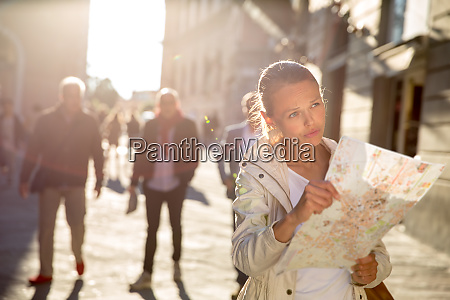 gorgeous female tourist with a map