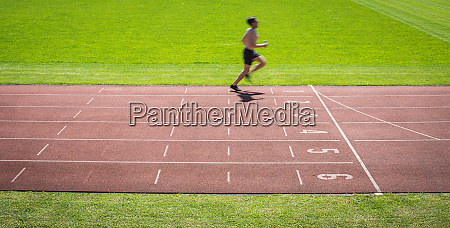 runner on a running track finishing
