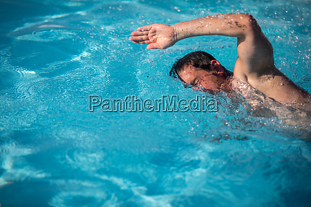 male swimmer swimming crawl in an