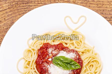 spaghetti heart on dark wood