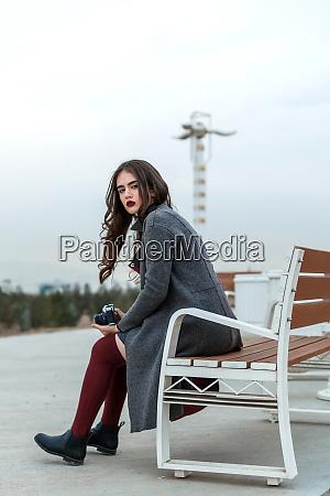 young beautiful girl in burgundy stockings