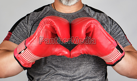 athlete in red boxing leather gloves