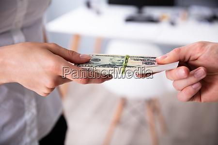 humans hand exchanging the money