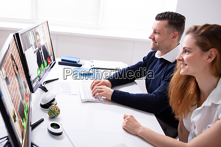 businesswoman and businessman video conferencing with