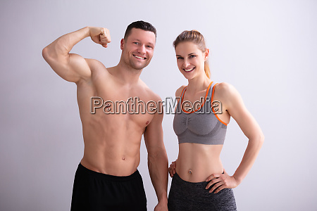 couple showing muscles