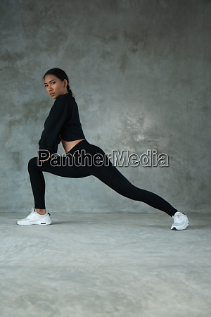 happy healthy woman stretching at the