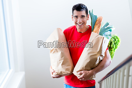 delivery man delivering groceries