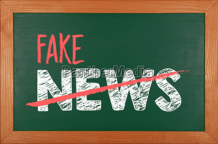 green school chalkboard with fake news