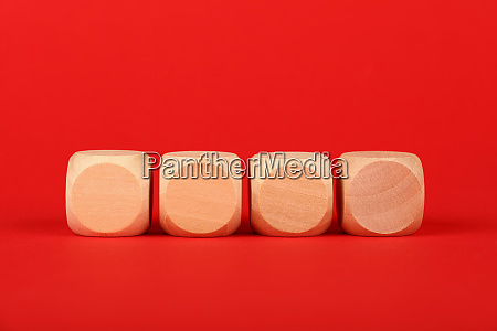 blank wooden cube signs over red