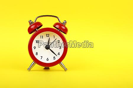close up one red alarm clock