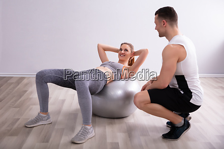 young woman doing workout with fitness