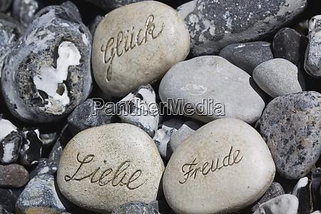 engraved stones german words joy luck