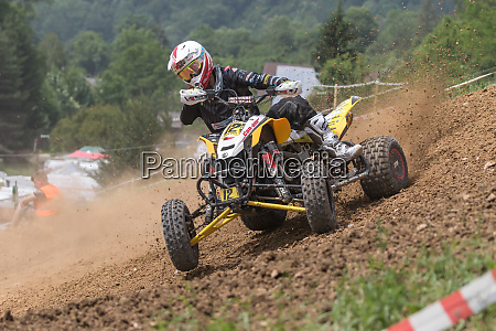 young quad rider in black skidding