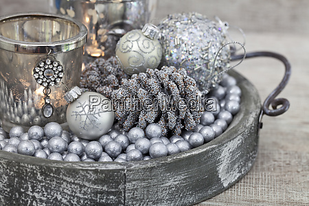 christmas decoration in silver with candle