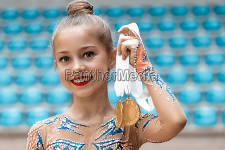 happy gymnast received a gold medal