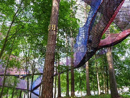 treetop net trampoline park in forest