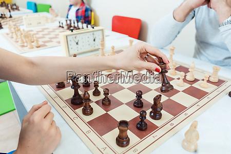 woman making a chess move playing