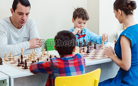 people playing a chess tournament