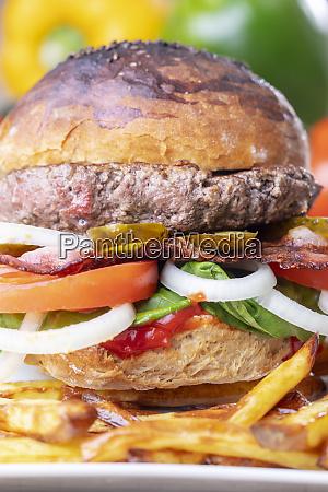 closeup of a hamburger with fries