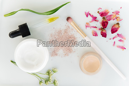 eyeshadow skin care products and flowers