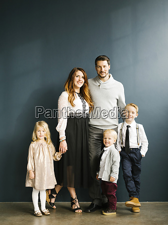 well dressed family with three children