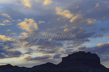 silhouette of rock formations under clouds