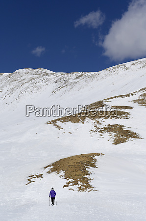 woman hiking on loveland pass in