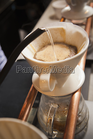 water being poured into filter coffee