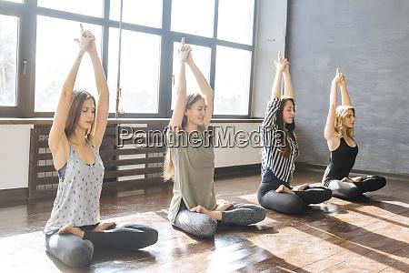 women during yoga class