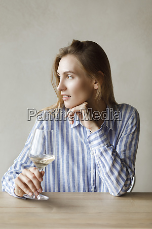 young woman with glass of white