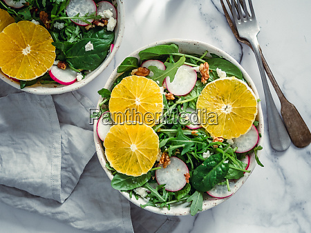 salad bowl with oranges spinach arugula