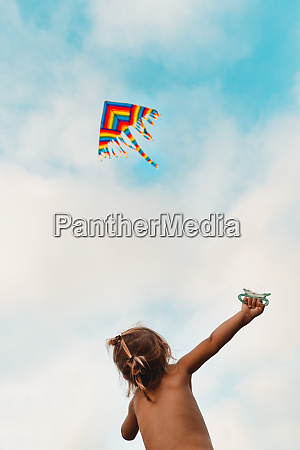 happy child launches a kite
