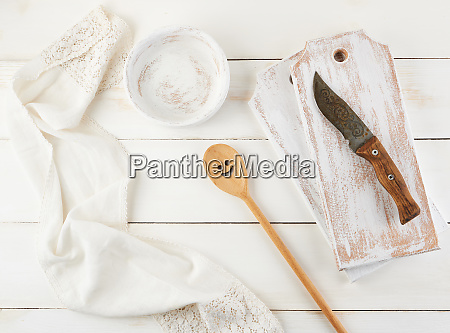 wooden spoon plate knife and a