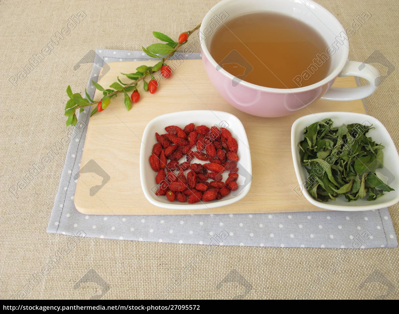 Tea With Dried Goji Berries And Goji Leaves Royalty Free Photo