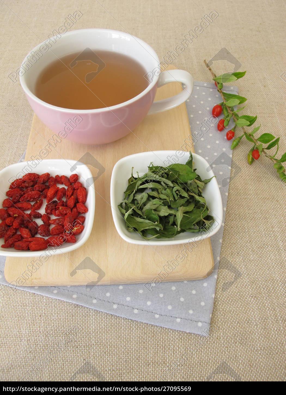 Tea With Dried Goji Berries And Goji Leaves Stock Photo