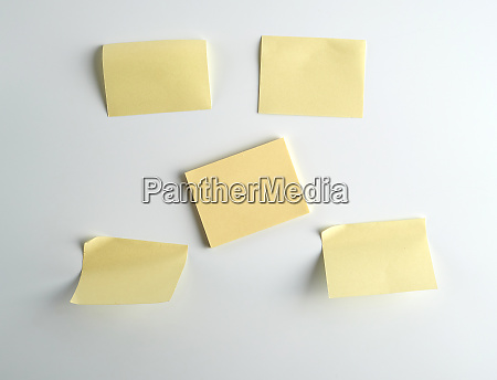 yellow paper stickers on white background