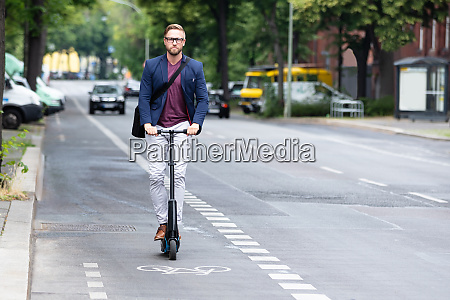 young businessman travel with electric scooter