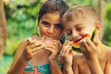 happy friends eating watermelon