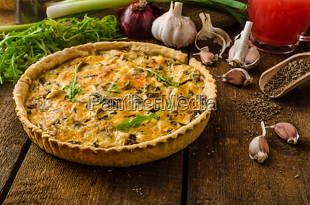 cheese quiche with chicken arugula and