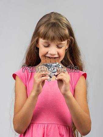teen girl with pleasure bites chocolate