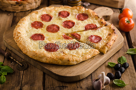 rustic pizza with tomato cheese salami