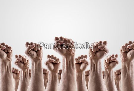 large group of raised hands showing