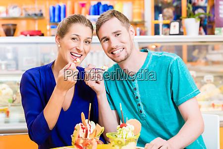 couple enjoying a sundae in the