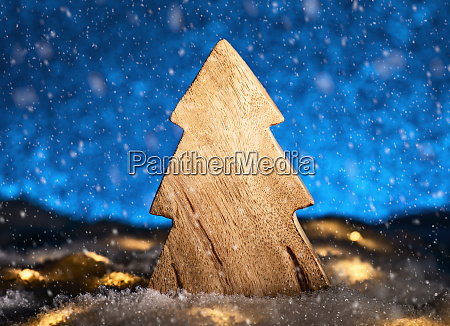 wooden christmas tree in front of