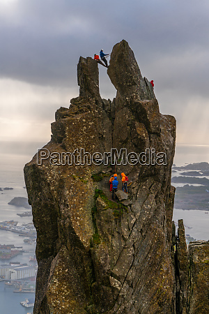 a group of people climbing on